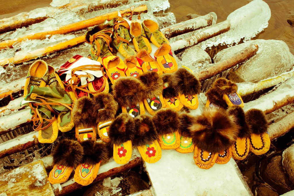 Some of the Mukluks made by the Webequie youth that incorporates beadwork, furs, hide, fabrics and leather. Photo courtesy of DAREarts.